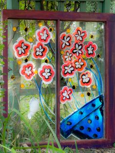 Painted an old abandoned window with acrylic paints. Another great backyard project this summer. When the sun shines through, it seems to shimmer. Sandra's Art Works