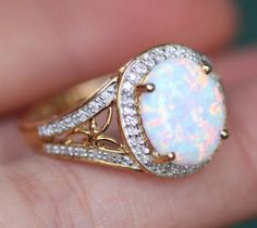 LOVE LOVE LOVE OPALS. It's my birthstone and I'm absolutely obsessed. Need to get a nice piece of opal jewelry someday, not necessarily a ring though
