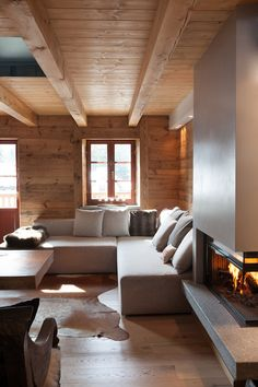 Every single part of this home is stunning, from the Scandinavian style living room to the chalet/castle feel bedroom. Design by archstudiodesign. Chalet Interior, Interior Design, Living Room Scandinavian, Scandinavian Style, Minimalist Apartment, House In The Woods, Living Area, Luxury Homes, Bedroom Decor