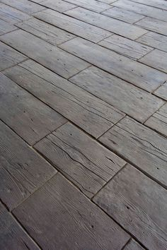 "Rustic wood? Nope - 2"" thick concrete pavers. 'Barn Plank Landscape Tile' by Silver Creek Stoneworks, Rochester, MN. Ideal for outdoor paths, decks, etc. (Riser steps also available.) http://www.silvercreeksw.com/barn-plank.htm#.VNv0_0fF_RY"