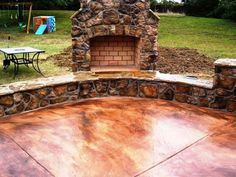 acid stained concrete patio with fire place.