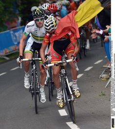 Sammy Sanchez gets tangled in a fan's flag in the mens road race championships-- Cycling