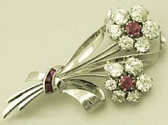 A very fine and impressive vintage 6.85ct Old European round cut diamond, ruby and platinum, flower spray brooch: part of our jewellery range  http://www.acsilver.co.uk/shop/pc/6-85-ct-Diamond-and-Ruby-Platinum-Brooch-Antique-Vintage-170p3469.htm#
