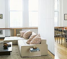 A clever way to divide a large space: a cloth hung from the ceiling to floor!