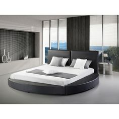 Modernize your bedroom with this specially design modern round bed. Black Faux Leather Round Platform bed frame with headboard is made with high quality smooth matte black vinyl and underlying foam. Platform Bedroom, Modern Platform Bed, Platform Bed Frame, Upholstered Platform Bed, Upholstered Beds, Bed Frame And Headboard, Headboards For Beds, Modern Queen Bed Frame, Trendy Tree