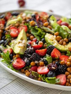 This triple berry salad is topped with cinnamon crunch chickpeas and the most delicious shallot vinaigrette. Perfect for the 4th of July and Perfect for summer! howsweeteats.com