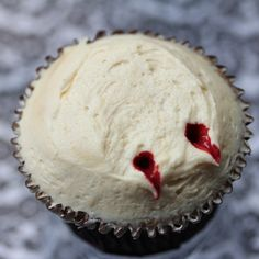 Decorate your Cupcakes with White Icing then POKE two holes to make it look like FANG Marks from a Vampire. Finish off with Red food dye or Red Food Gel from Tube.