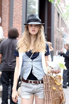 like the style, all mix-up: denim shorts, stripped vest, blue shirt and a hat