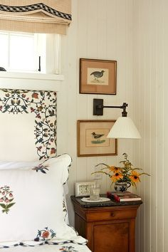 Fresh Farmhouse.  Like the way the prints are hung on either side of the reading lamp.