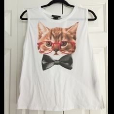 Forever 21 Tank w/ Glasses Bow tie Cat Graphic Cotton/Polyester white tank with picture of kitten with red glasses and black bow tie in front. Slight signs of wear.  FEEL FREE TO MAKE ME AN OFFER!  #tank #tanktop #kitten #cat #kitty #glasses #bowtie #caturday Forever 21 Tops Tank Tops