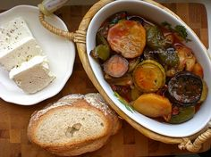 Briam (Greek Baked Vegetables) served with feta and bread.