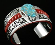 Michael Perry RARE Gem Grade Carico Lake Spiderweb Turquoise and Coral Bracelet   eBay Navajo master jeweler Michael Perry has created this  wonderful bracelet by overlaying two sheets of heavy  gauge sterling silver. The design is created by  precision cutting of the silver into a sunbeam pattern.  Sunbursts line the bracelet shank and are made even more beautiful with the darkened background used to accentuate the detail. $2700