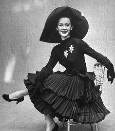 19-11-11  Sophie Malgat, 1951    Sophie is wearing a skirt featuring three-tiers of ruffles completed with a long-sleeved top. Photo by Gordon Parks.    Photographed for LIFE Magazine.