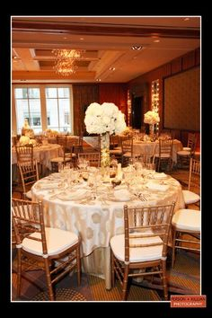 White Centerpieces Chairs Indoor Reception Wedding Reception Photos & Pictures - WeddingWire.com