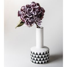 Bloomingville White & Black Geometric Bud Vase: Ceramic bud vase from Bloomingville. A comtemporary, Scandi style, with a narrow neck - perfect for displaying a single flower. White ceramic with a black geometric print design. Flowers not included.
