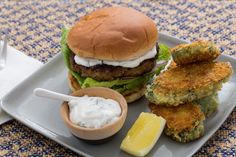 Vadouvan-Spiced Lamb Burgers with Crispy Curried Zucchini Rounds. Visit https://www.blueapron.com/ to receive the ingredients.