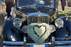 Fioreria Oltre/ Baby's breath and white rose wedding car decoration
