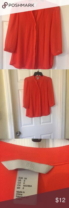 H&M blouse in red/orange color size 8 H&M blouse in red/orange color size 8. Lightly woren in good condition. H&M Tops Blouses