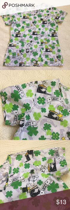Peanut Lucky Charm Scrubs Top Super cute scrubs Top! Who could use some luck every day? I know, I could!! 🤗 my friend got this cuteness but didn't use it. Offers accepted!! Peanuts Tops