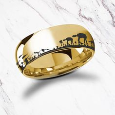 8mm is the default width for this ring. This ring is available in 4mm, 6mm and 8mm. If you prefer a different width other than 8mm, please note this in your order notes!  This is a domed polished yellow gold plated tungsten carbide ring with an awesome Star Wars battle of the Hoth scene engraved on the outside of the ring. You can pair this outside Star Wars battle scene engraving with any quote engraved on the inside, including quotes from the film!  Lifetime Size Exchange Warranty Its…