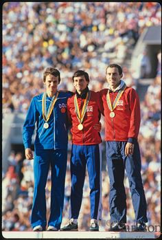 19 JULY - 03 AUG 1980:  Moscow Summer Olympics: Mens 1500m winners: Sebastian Coe of Great Britain (center with gold medal), Jurgen Straub of East Germany (left with silver), and Steve Ovett of Great Britain (right with bronze)..Photo: © Rich Clarkson / Rich Clarkson & Associates