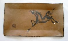 A galloping horse on a large brown stoneware plate by Tracie Griffith Tso of Reston, Va. Animal Symbolism, New Year 2014, Year Of The Horse, Lunar New, Chinese Painting, Silk Painting, Stoneware, Plate, Pottery