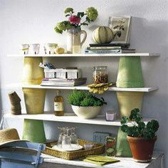 shelves using flower pots!  From facebook page creative solutions