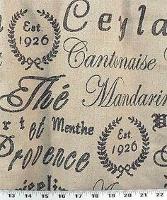 French script design printed on a rustic burlap / linen textured fabric (similar to barkcloth). Description from pinterest.com. I searched for this on bing.com/images
