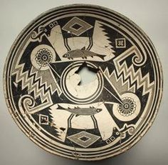 Classic Mimbres black-on-white ceramic bowl with antelopes standing on fish, surrounded by stepped frets and floral designs, New Mexico. Collection of Art Institute of Chicago.