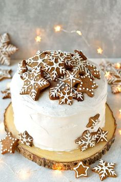 Rich Christmas fruitcake topped with marzipan, royal icing and gingerbread stars and snowflakes