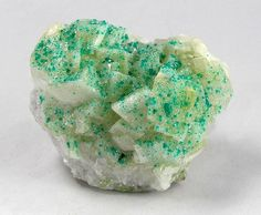 Tiny Dioptase crystals on euhedral Calcite