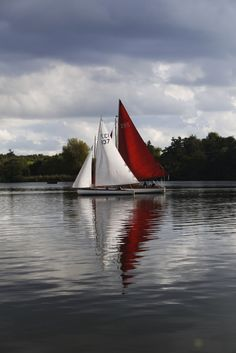 Photograph by Yasmin Stopford. Yacht. Reflections. Colour. Wroxham Broad. Norfolk. Norwich.