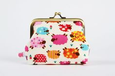 Metal frame coin purse  Colorful sheep on beige  Deep by octopurse