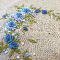 Embroidered blue roses.