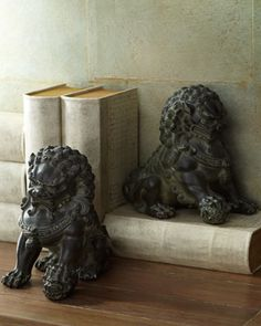 Two Antique Lion Statues look fabulous in this tone on tone decor!