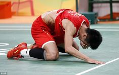Despite clinching the match comfortably, Long was seemingly in disbelief after winning gold