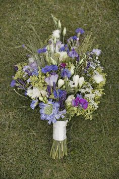 wildflower bouquet - would not want purple but like the blues if mixed with peaches / pinks / nudes