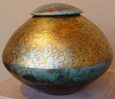Raku Pottery by Rick Lowenkamp.  I love the Raku pieces that blend in the metallics with their color.
