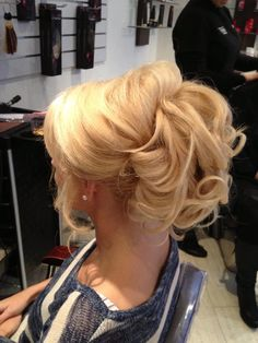 Halo Extension Updo...Fold the halo in half wrap the wire around the pony tail, secure the halo with bobby pins use a piece of hair and wrap around the base of the pony tail so you can't see the stitching then create a style from that.