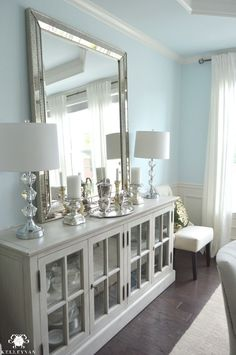 Restoration Hardware French Casement Cabinet in Dining Room with Buffet Lamps and Vertical Leaning Mirror