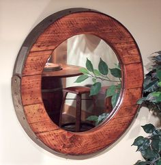 The Barrel Ring Western Mirror is made from a wine barrel top with a hand forged flat iron ring border. Available in your choice of finish options. Made in the USA. Timber Furniture, Rustic Furniture, Furniture Ideas, Wine Barrel Rings, Wine Barrels, Wine Ring, Wine Cellar, Western Mirror, Barrel Projects