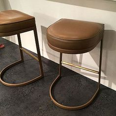 Emporium Home delivers an instant classic in any home with the Geo Bar Stool. This elegant seating brings sophistication to any bar with its sleek, leather-wrapped frame, accented with brass detail and top-grain leather seat. *Choose color below.