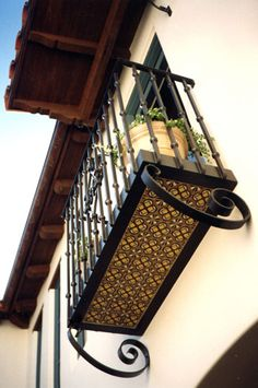 #balcony detail, wrought iron balcony with hand painted tile. #SpanishColonial Style Architecture.  Juliette Balcony