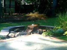 Landscape Designer: John Bowles of New Leaf Landscape Designs in Fayetteville, NC. Small Bed Designed with Boulder, Water Feature. Dwarf Maple added.