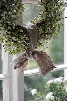 love the burlap tied around a simple wreath