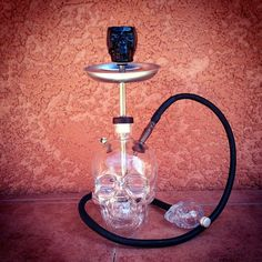 Skull Head Glass Bottle Shisha Hookah With Matching black Hose, Tray, and Bowl Made with crystal skull vodka glass and yes they do carry the mini version to make this hooka pipe!