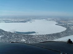 Clear Lake, Iowa in the winter. The open water is due to the aerators in operation, just south of the Main Ave boat ramp.