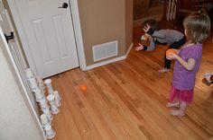 Orange / paper cup bowling.