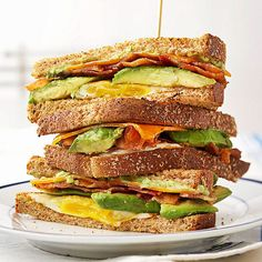 Cover all your breakfast bases with this delicious Fried Egg, Avocado, and Bacon Breakfast Sandwich: http://www.bhg.com/recipes/breakfast/breakfast-sandwiches/?socsrc=bhgpin013014breakfastsandwich&page=12