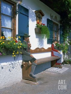 Figures Carved on a Bench on a Decorative House Front at Garmisch Partenkirchen in Bavaria, Germany Photographic Print by Gavin Hellier at Art.com